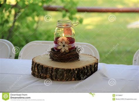 jar and wood centerpieces wood and jar candle centerpiece on table at