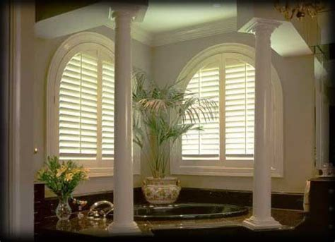 window coverings arched windows arched windows in the bath with classic arched shutters