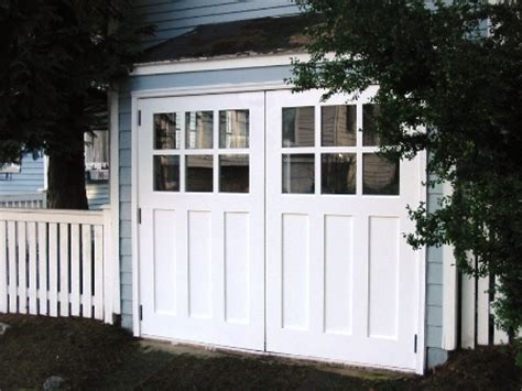 Garage Doors That Open Out by Made Custom Carriage Garage Doors And Real Carriage