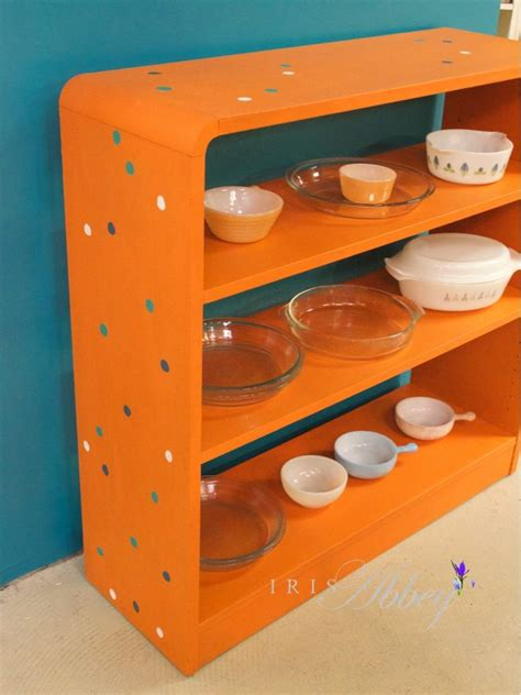 ascp barcelona orange bookshelf with spots iris