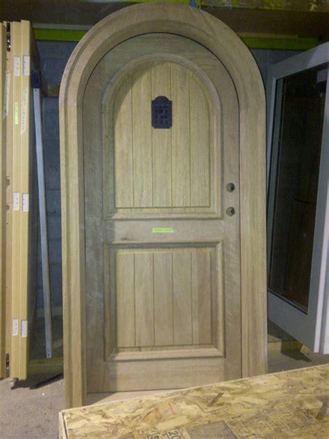 Front Door With Speakeasy Arch Top Mahogany Door With Speakeasy Traditional Front Doors Vancouver By Doorex
