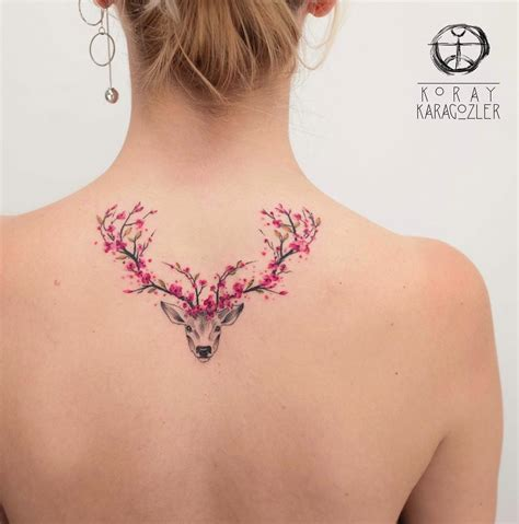 deer with pink floral antlers best tattoo design ideas
