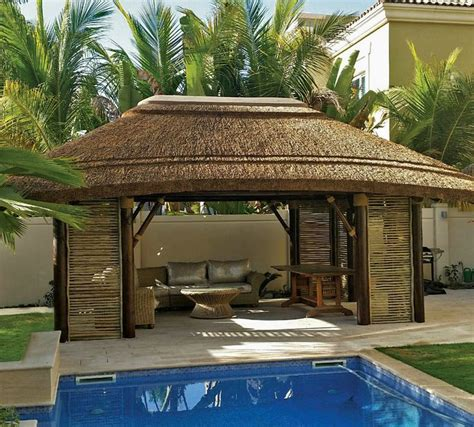 thatched gazebo  lath sides  decor perfect  hot