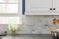 new caledonia granite countertops and white glass tile home depot backsplash tiles best kitchen design