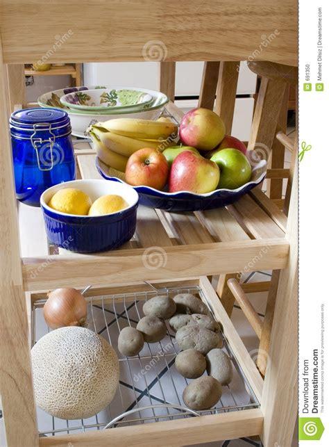 Shelf Of A Potato by Kitchen Island With Fruits Lemon Potatos On The