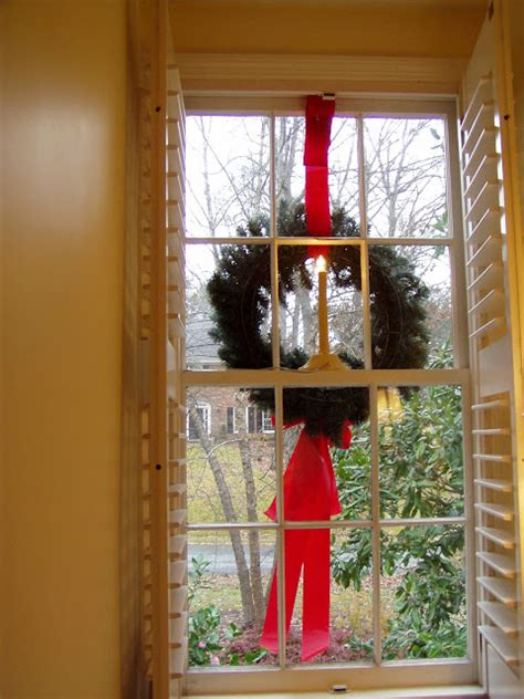 images of christmas wreaths on windows how to hang wreaths on outside exterior windows