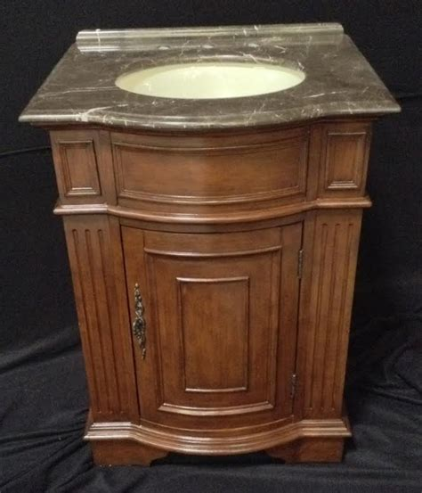 26 inch single sink bathroom vanity with brown parquet