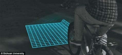 Grid Pattern Bike Light | the bike light that can reveal potholes grid projected