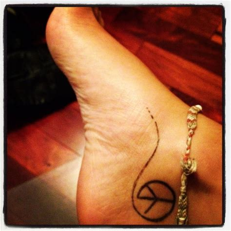 small peace sign tattoo the 25 best peace sign tattoos ideas on