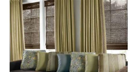 white curtains with brown trim brown bamboo blinds with dark wood trim and curtains to