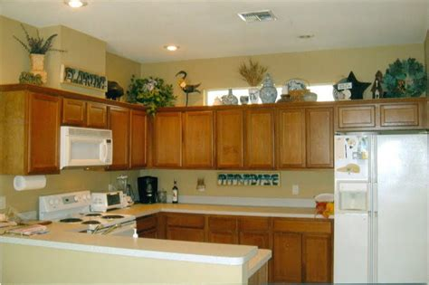 top of kitchen cabinet ideas the tricks you need to for decorating above cabinets