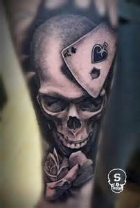 realistic skull rose and card tattoo black and grey