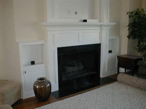 custom  built  fireplace mantle  flat screen tv