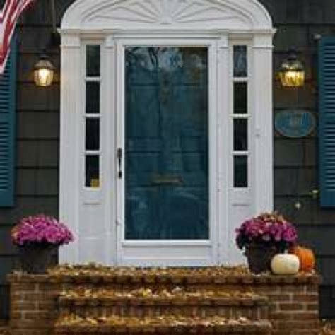 teal front door this color teal front door with our white siding and