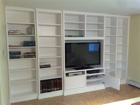 built in white lacquer wall unit adjustable shelving