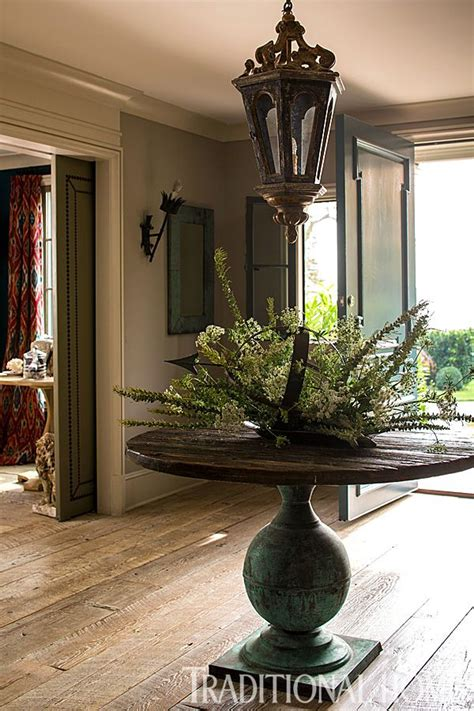 Vintage Foyer by An Antique Pedestal Table In The Foyer Sets The Homes