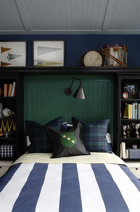 dark blue boys bedroom bookshelves flanking bed traditional boy s room