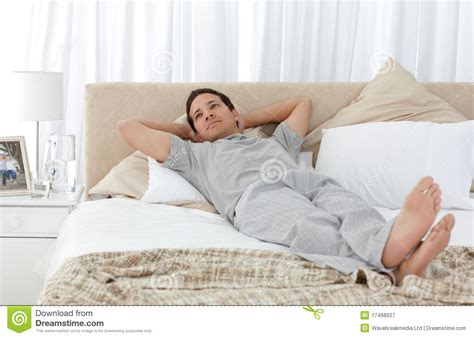lying on bed tranquil man lying on his bed royalty free stock