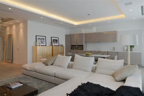 open plan apartment lighting details create drama in modern open plan