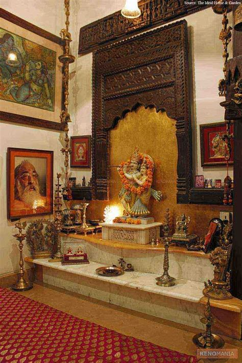 an elegant puja room with marble floor and hanging bells