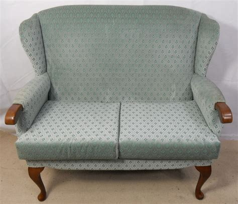small two seater settees sold upholstered two seater wingback fireside sofa settee