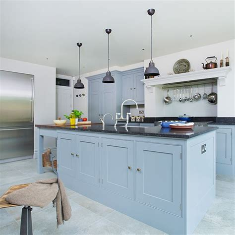 blue grey painted kitchen by peter henderson furniture kitchen with white cabinets and blue island this tranquil