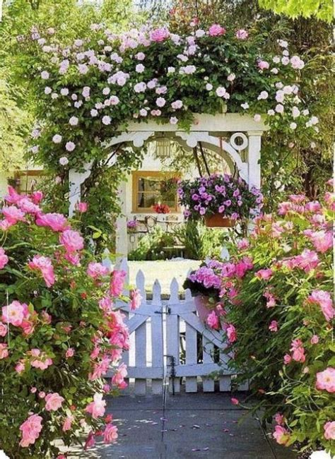 Garden Gate Flowers Arbor Gate Loaded With Flowers Through The Garden Gate