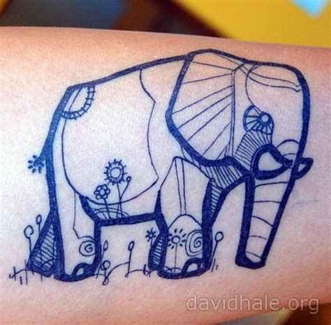 elephant tattoo meaning trunk up fleur elephant tattoo i would have the trunk turned up