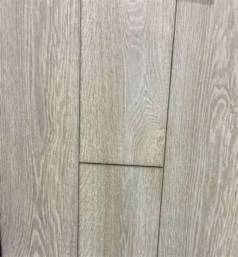 Vinyl Laminate Flooring by Laminate Vs Vinyl Flooring Paradigm Interiors