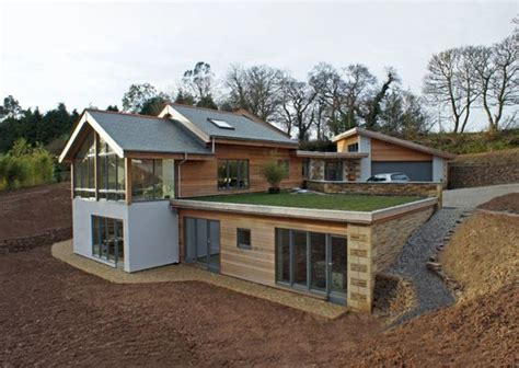 Level Homes | contemporary part earth sheltered split level house truro