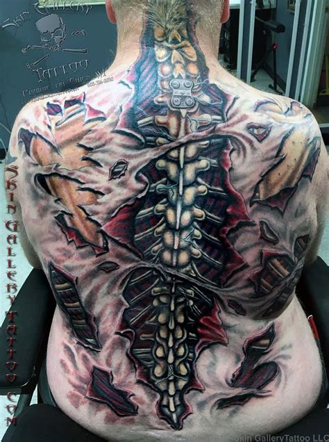 ripped skin color backpiece by brent severson tattoos