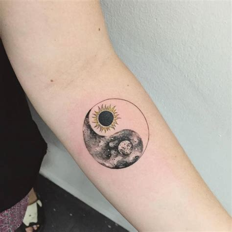 small matching tattoo sun moon yin yang on the forearm small