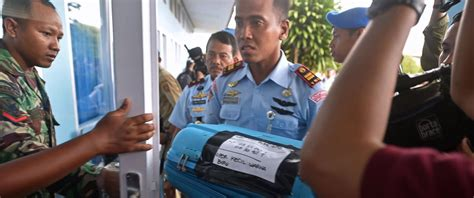 airasia news today airasia bodies debris found in search for missing jet
