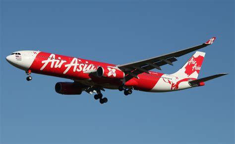 airasia flight grounded after apparent bird strike damages airasia flight turns back to brisbane after apparent bird