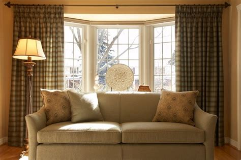 Ordinary Simple Window Treatments For Large Windows #4: Curtain-rods-for-bay-windows-Living-Room-Traditional-with-blue-chair-blue-sofa.jpg