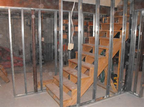 studding a basement metal studs to frame the stairs and partition wall in