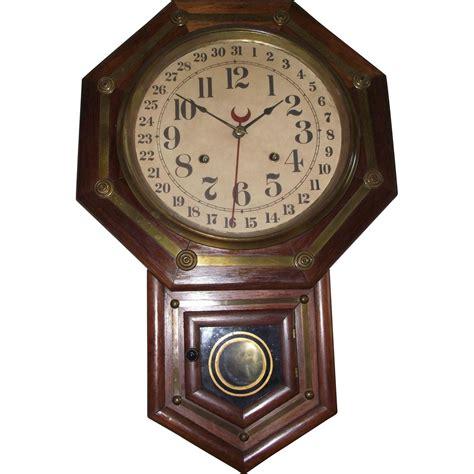 clock made of clocks rich rosewood brass trim short drop regulator clock made