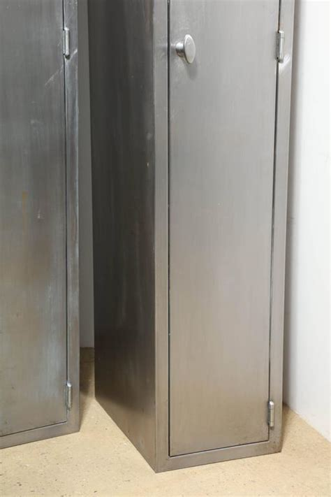 tall narrow armoire two tall and narrow 1950s industrial brushed steel armoires at 1stdibs