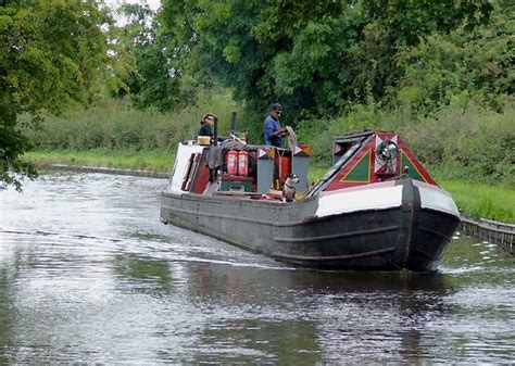 sailing hire near me working narrowboat approaching deptmore lock near