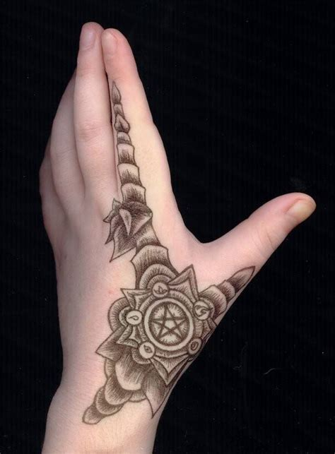 cross tattoo between thumb and index finger tattoos for designs and ideas for guys