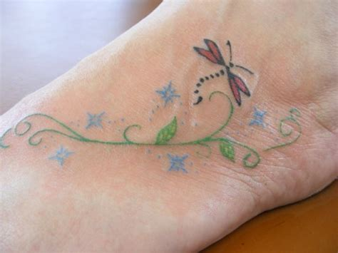 small dragonfly tattoo on foot 25 undeniably dragonfly tattoos pictures webdesignlayer