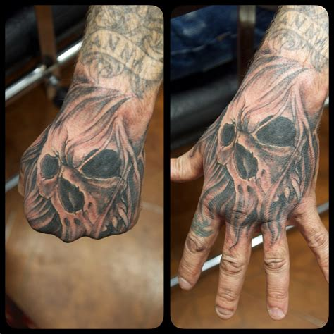 tattooed hands skull marecuza piercing