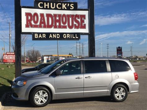 chucks sign and new dodge caravan picture of chuck s