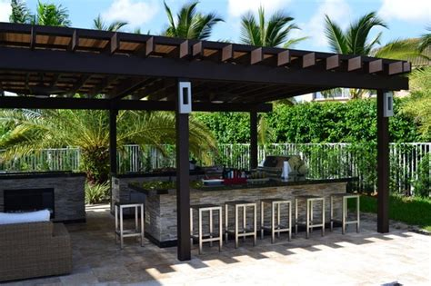 outdoor pergolas covered outdoor kitchen weatherproof tropical styled patio for large space using covered