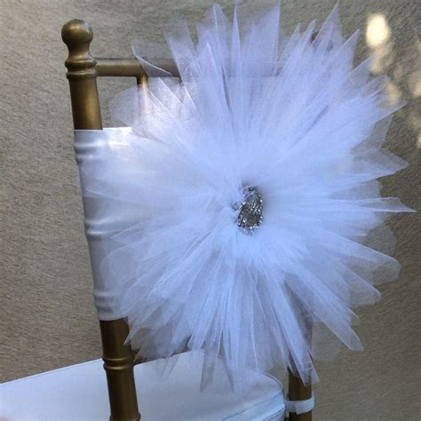 White tulle chair decoration with beautiful silver brooch