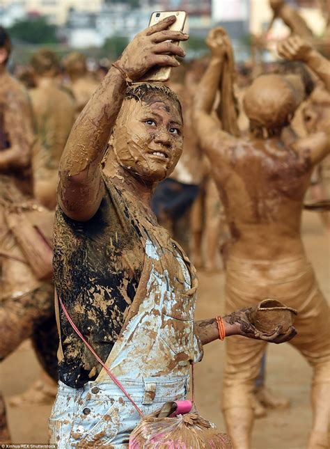 Muddy Mask tourists celebrate monihei festival which sees