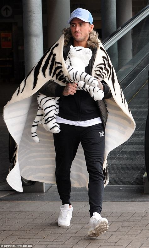 ikea tiger rug stephen bear wears an animal print rug as a cape during