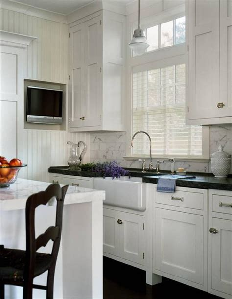 pendant light over kitchen sink kitchen transitional with glass schoolhouse pendant over farmhouse sink