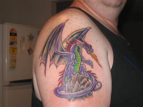 fire breathing dragon tattoo designs breathing on shoulder tattooshunt