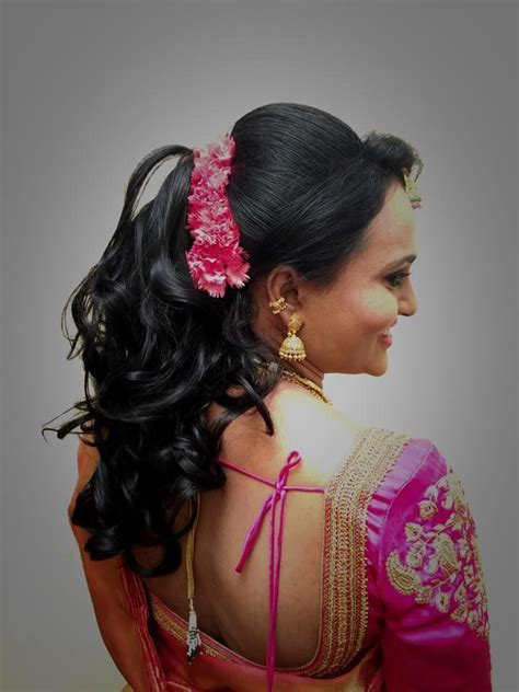 Indian bride's bridal reception #hairstyle by Swank Studio